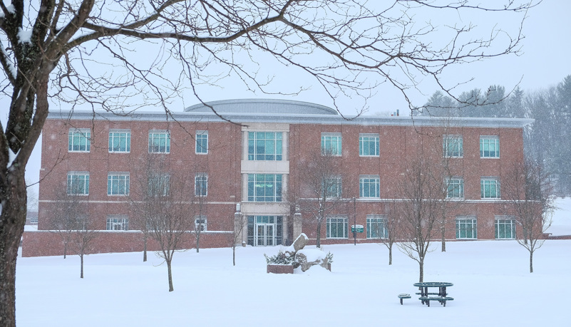 Physical Therapy building through the trees and snow