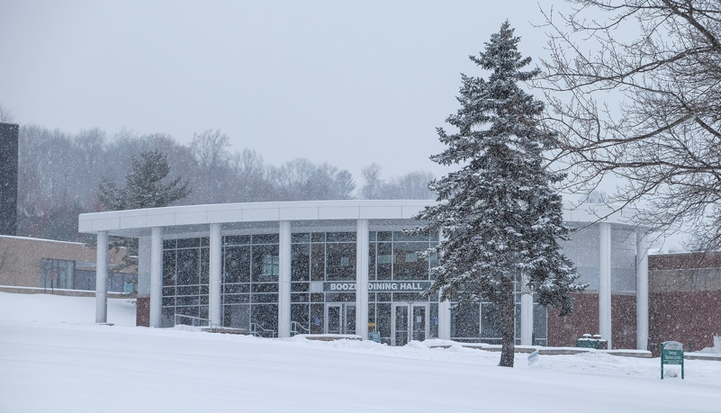 Boozel Dining hall through the trees and snow