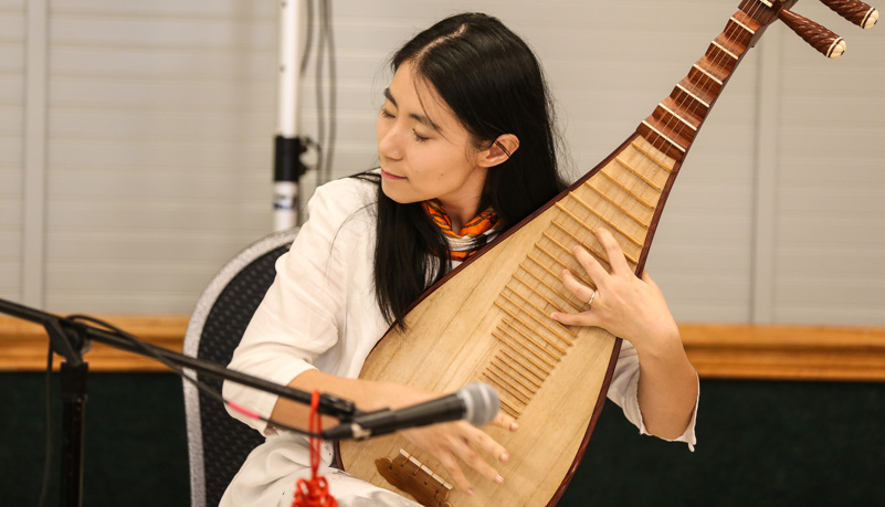 Woman playing traditional Chinese music