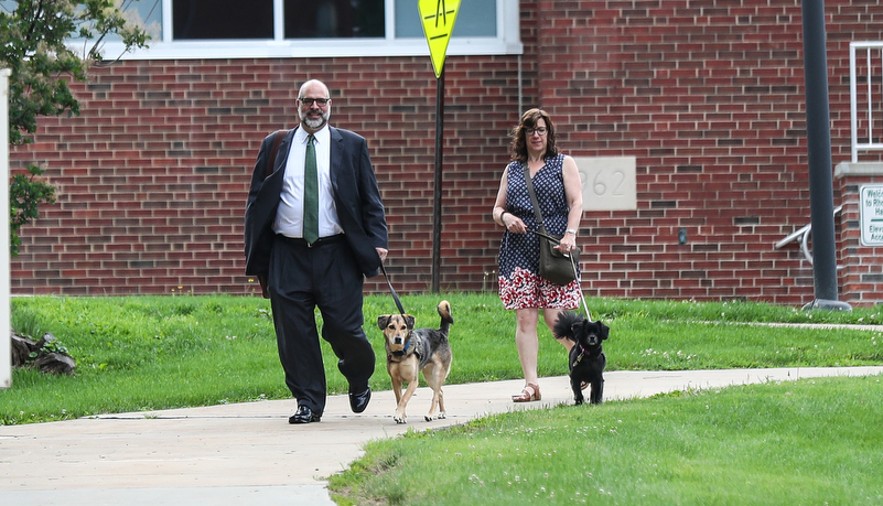 President Behre and his wife Leah walking their dogs