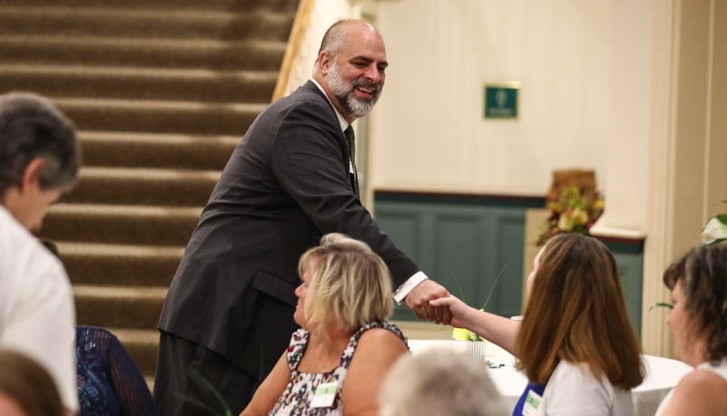 President Behre greeting employees at a reception