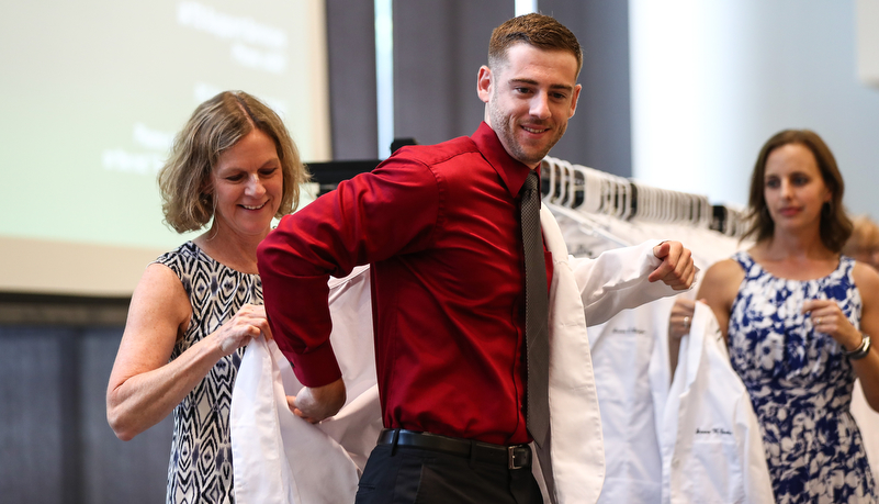 Student receives his white coat