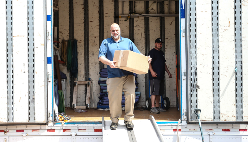 Dr. Behre unloading a box