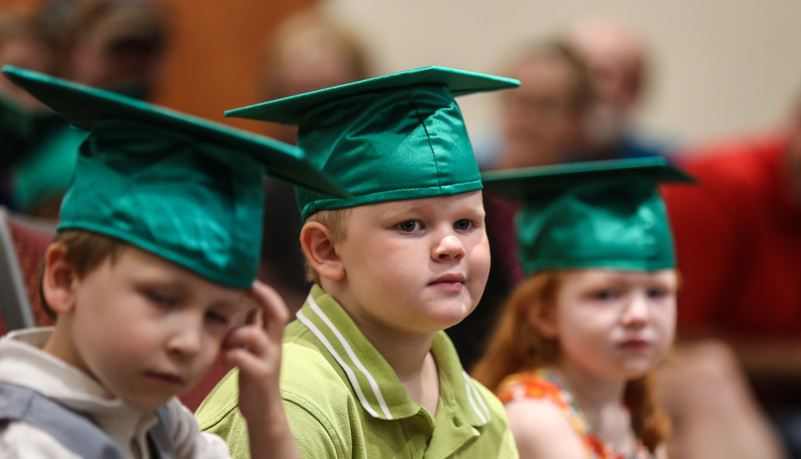 Pre-school graduates waiting to graduate