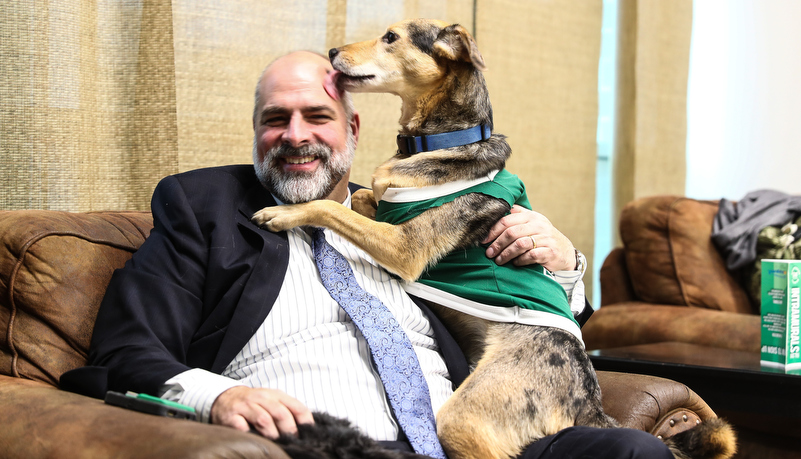 President Behre with his dog Oscar