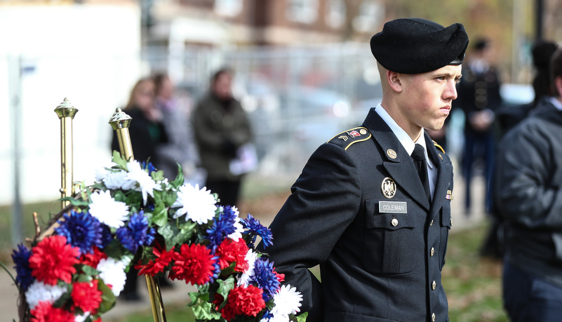 ROTC Cadet stands by a memeorial wreath
