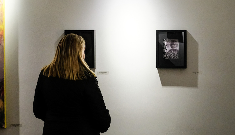 Woman looking at photos on the wall