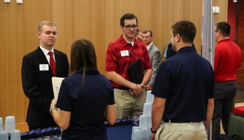 students talking to employers