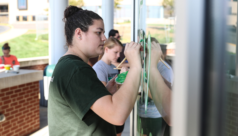 Students painting windows