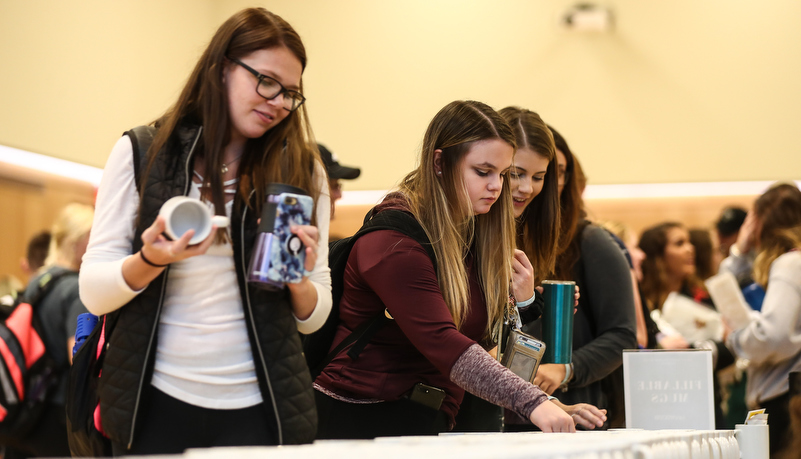 Students selecting a mug