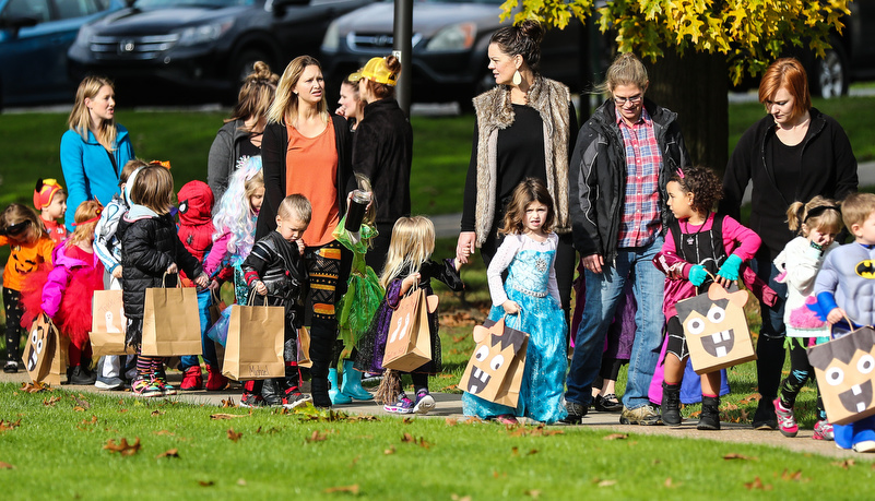 Pre-Schoolers trick or treating on campus