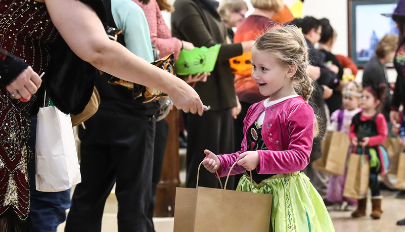 Girl in a costume getting candy