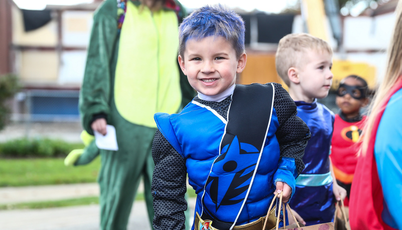 boy dressed in a super hero costume