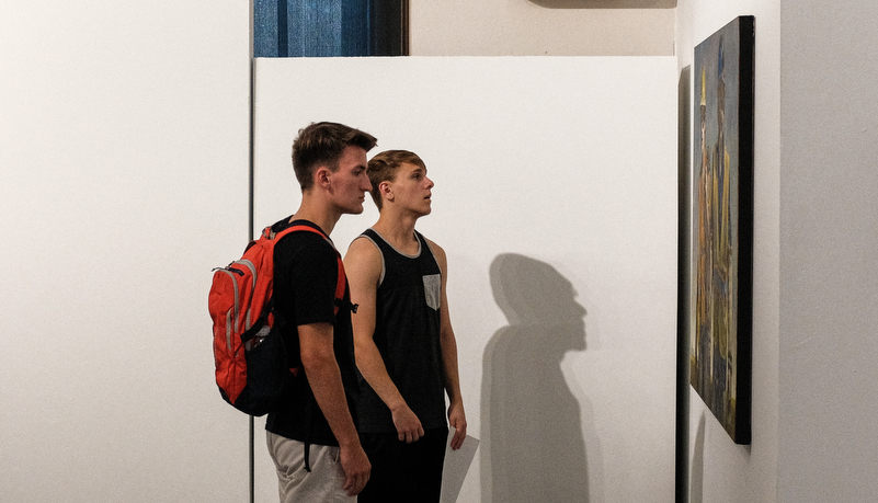 Vistors looking at art