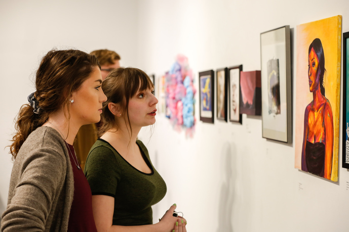 women looking at art