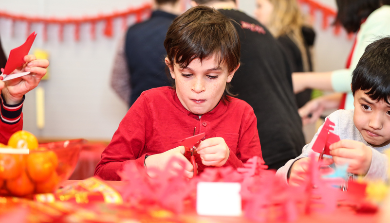 Child making Chinese crafts