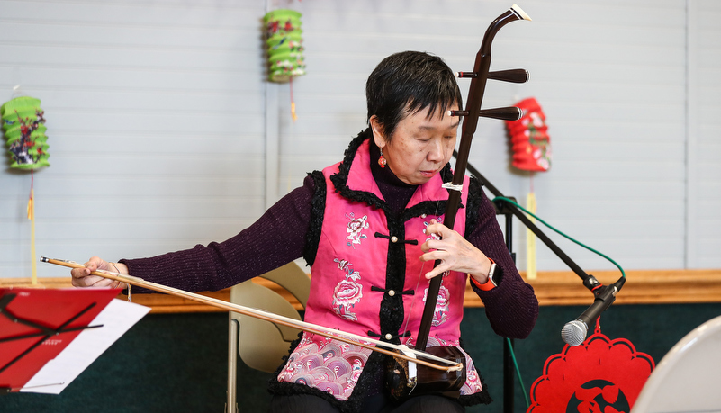 Woman playing traditional instrument