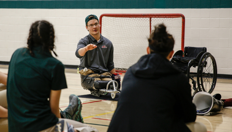 Students learning about sled hockey