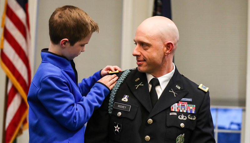 Col. Richey's sons pin on his tabs