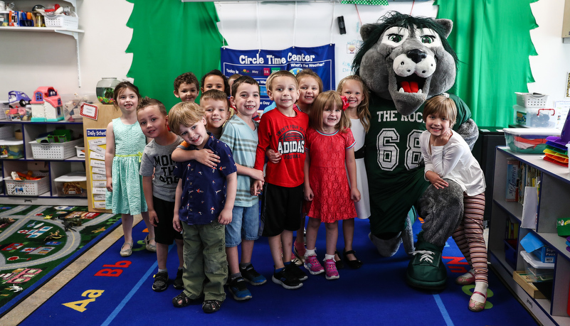 Pre-school children pose with Rocky