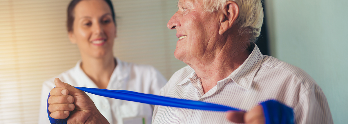 Occupational Therapist helping client with exercise bands