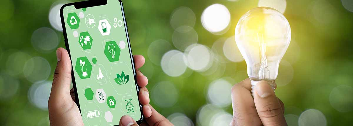 Picture of a hand holding iPhone and communicating about the environment