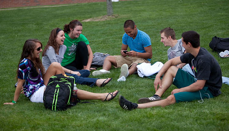 Students talking on a lawn