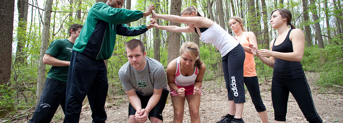 Students participating in teambuilding exercises