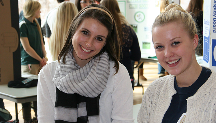 Two management students smiling