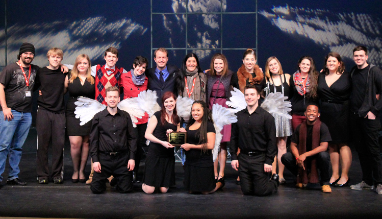 Theatre students displaying an award