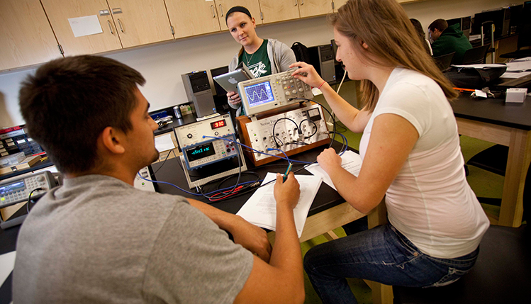 Physics students work in the lab