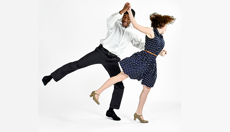 Students perform swing dance in the SRU Performing Arts Series