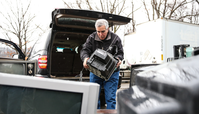 Man unloading recycled electronics