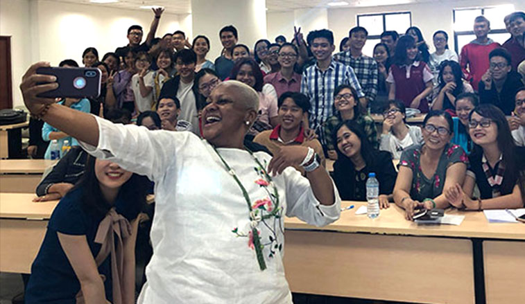 Professoer takes a selfi with students