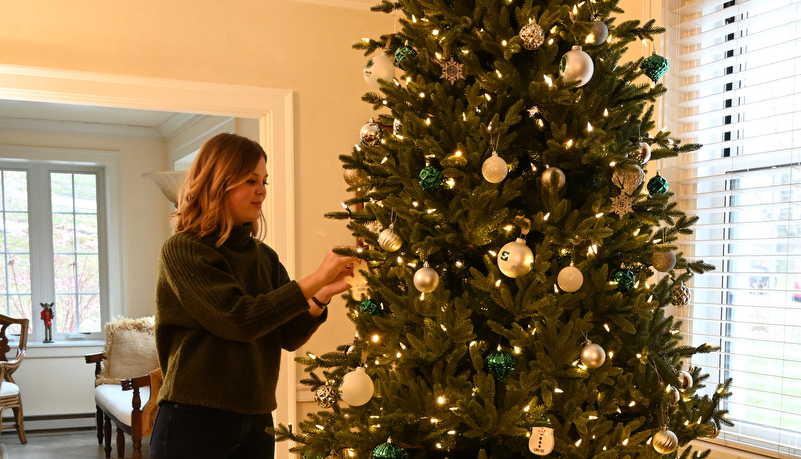 Woman decorating a tree