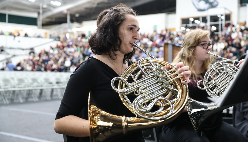 woman plays the french horn