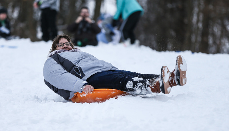 Students sled riding