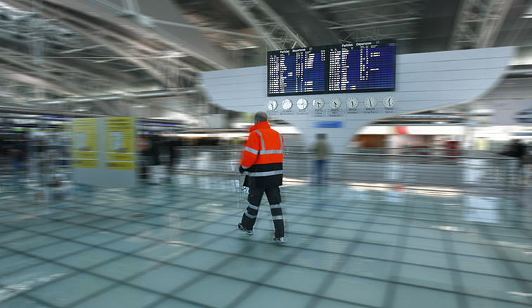 man walking through an airport