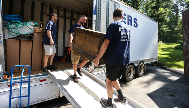 crew unloading the moving truck
