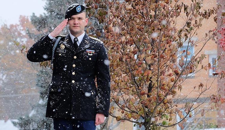 ROTC cadet saluting in the snow