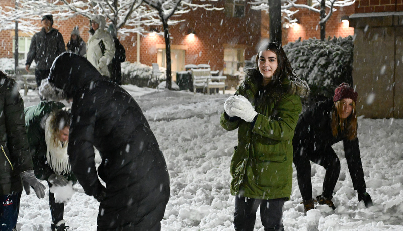 Students having a snowball fight