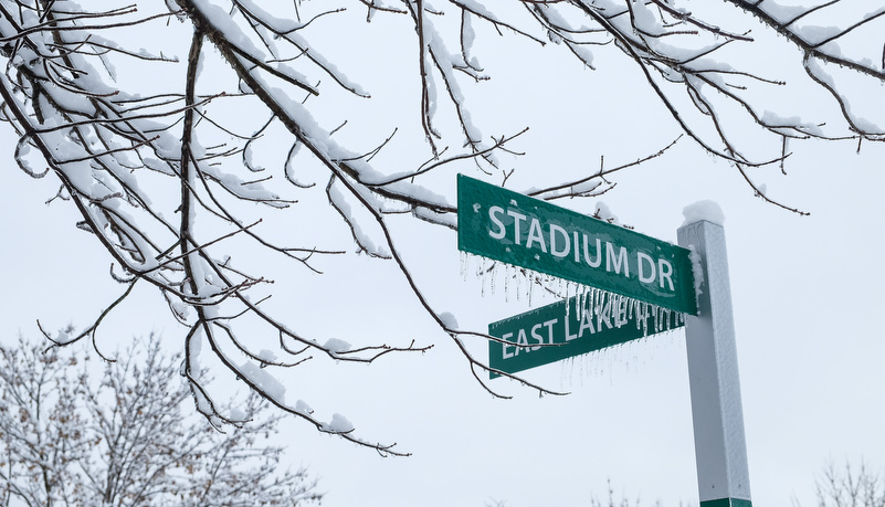 Stadium road signs covered in ice and snow