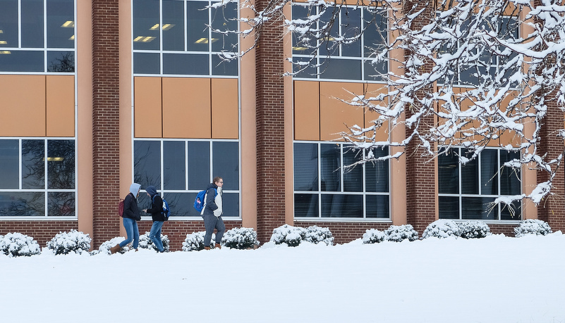 Students walking to classes in front of Vincent Science building
