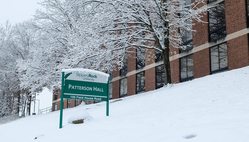 Campus sign covered in snow