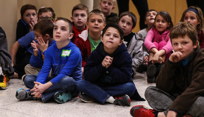 Second graders listen to a presentation