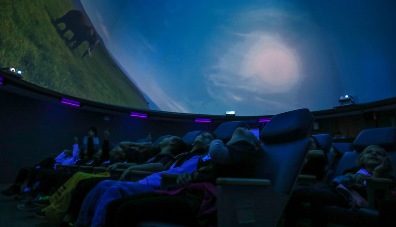 Second graders watch a show in the planetarium