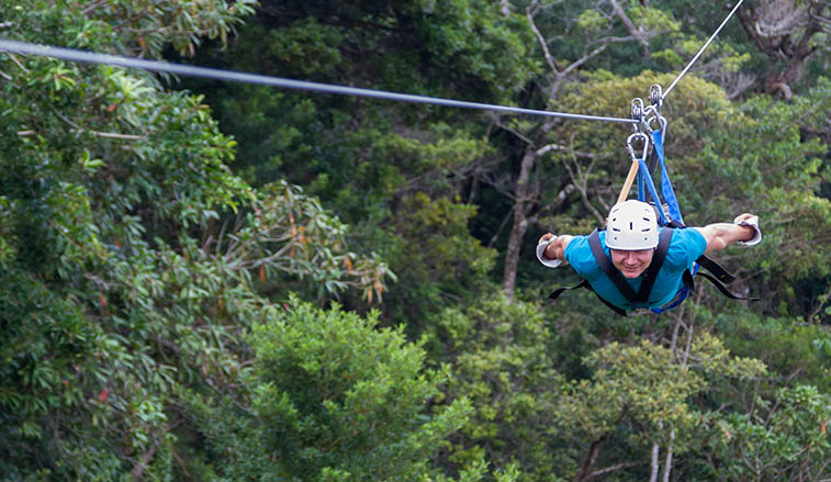 Man on a zip line in Costa Rica