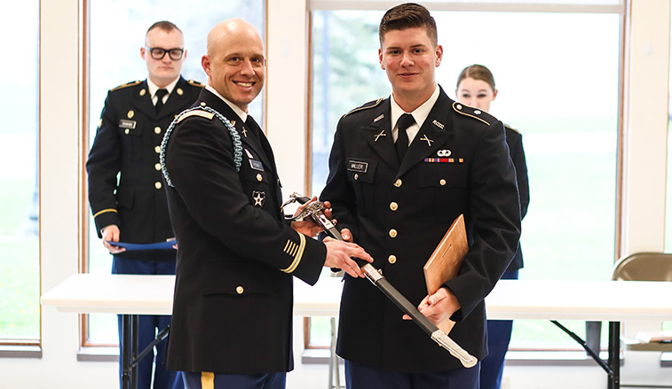 Senior cadre commander receiving his saber
