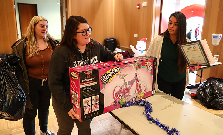 Holiday gifts collected at the University Program Broad's Season of Giving event at Slippery Rock University include donations for 75 children from various Butler County families in need through SRU's Elf Project.