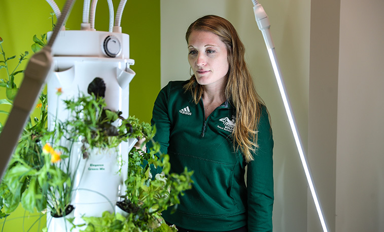 "At 58 inches high, the Tower Garden doesn't ""tower"" over the Slippery Rock University students who use the indoor plant growing system. However, as a tool for both classroom learning and professional development, the Tower Garden is helping SRU students reach new heights when it comes to wellness education."